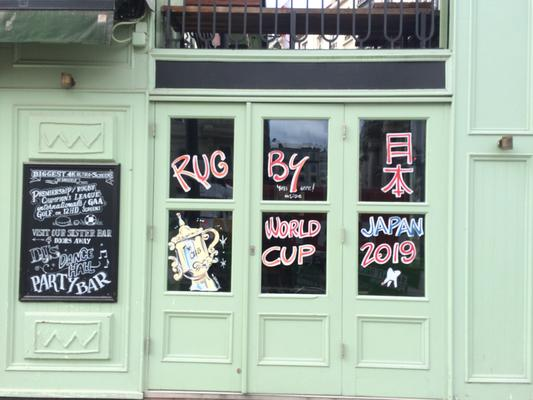 pub window with japan world cup paint on it